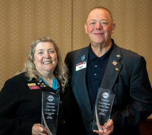 Jean and husband Dave with their Toastmasters awards.